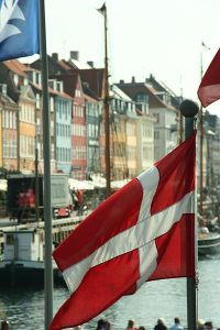 Flag of Denmark in front of Nyhavn, Copenhagen, Denmark. Photographed by Niels Bosboom.