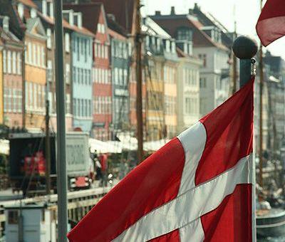 Flag of Denmark in front of Nyhavn, Copenhagen, Denmark. Photographed by Niels Bosboom.